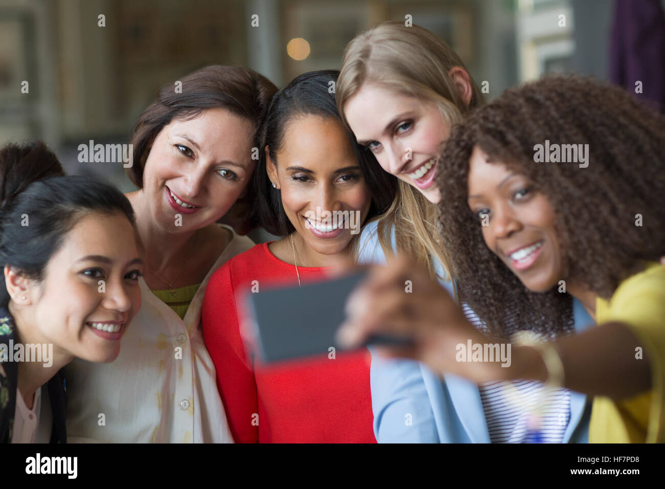 Women friends taking selfie with camera phone - Stock Image