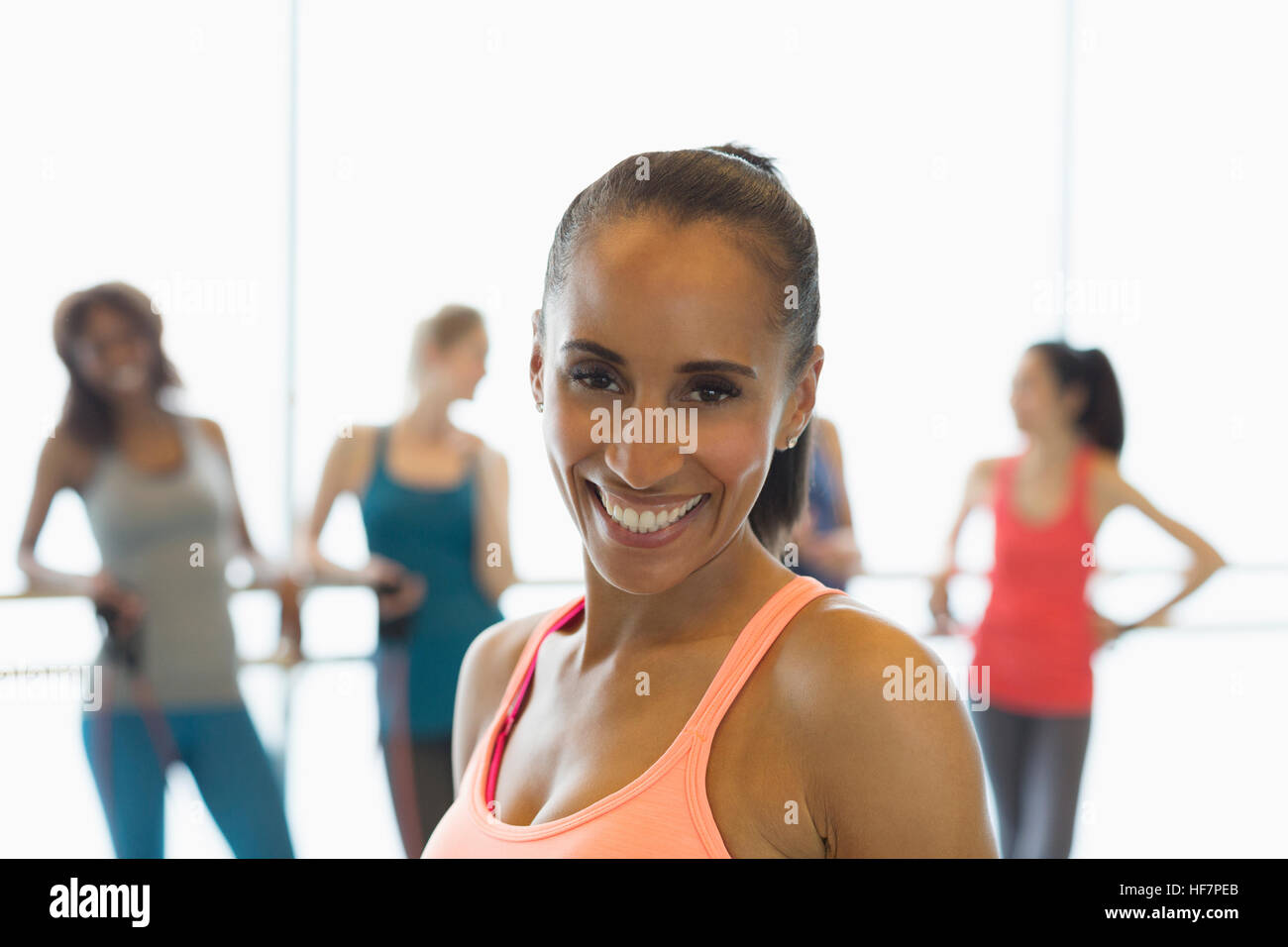 Portrait smiling woman in exercise class gym studio - Stock Image