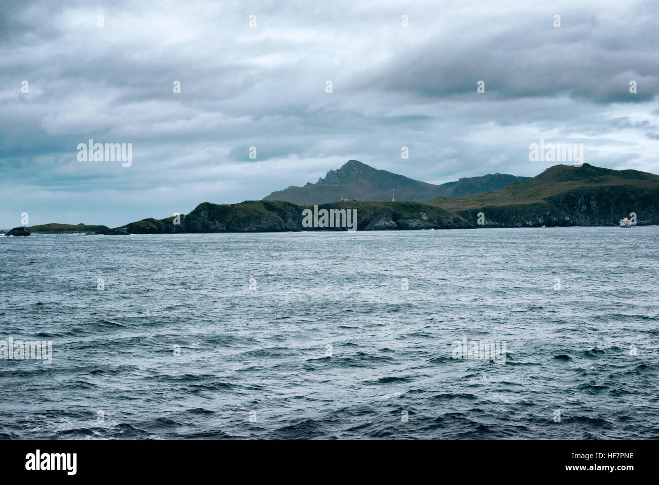 Cape Horn Lighthouse with Outpost and Chile Flag, Drake Passage, Chile - Stock Image