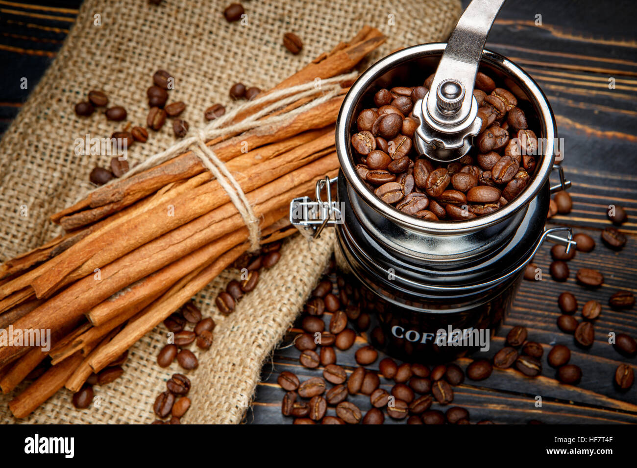 coffee mill and roasted beans on wooden background - Stock Image