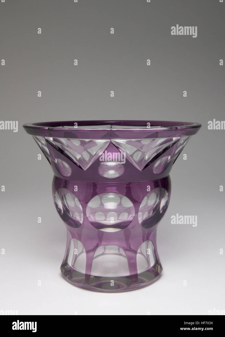 Stylish Art Deco Haida  glass vase, cased is purple and deep cut with a geometric design, made circa 1920. - Stock Image