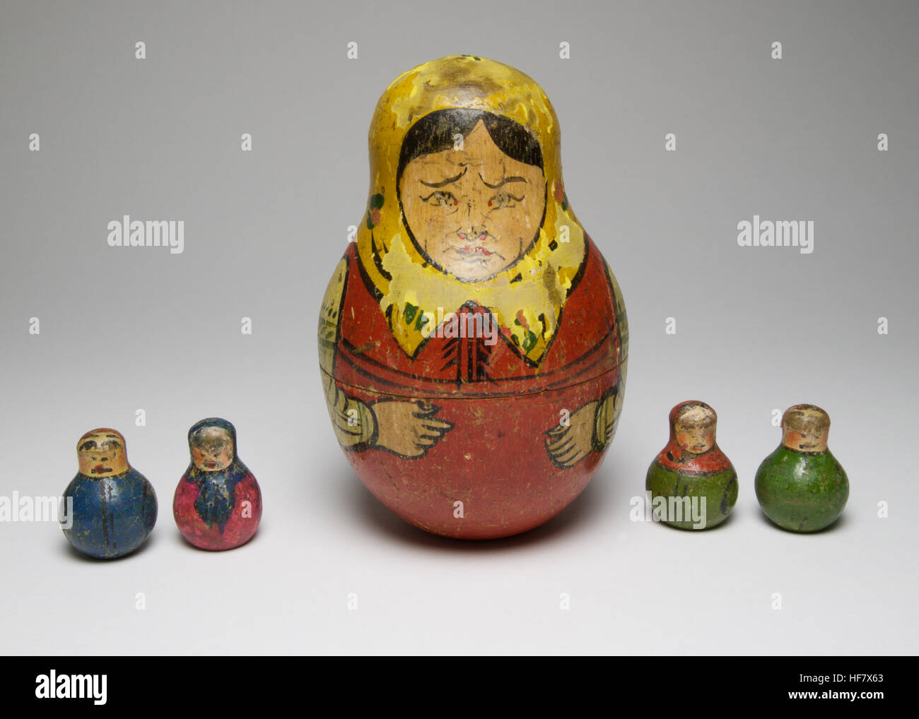Vintage handpainted Russian wooden doll, which contains 4 small weighted wooden dolls. The four small dolls are - Stock Image