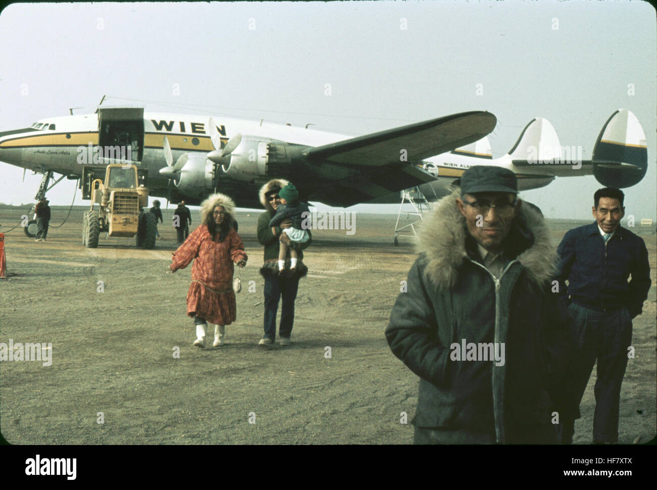 Eskimo people at airport; Point Barrow, Alaska.  No roads connect Point Barrow with the rest of the state. Planes - Stock Image