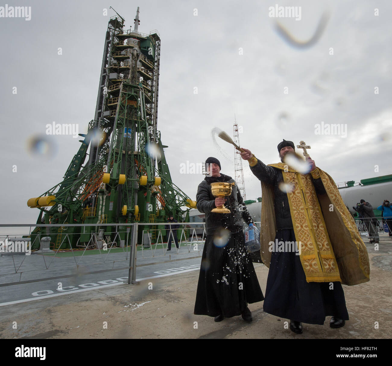An Orthodox Priest blesses members of the media after he blessed the Soyuz rocket at the Baikonur Cosmodrome Launch Stock Photo
