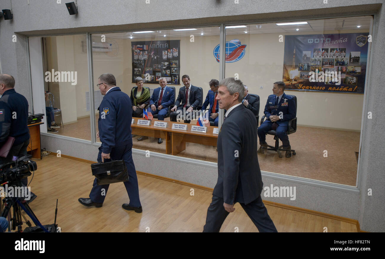 Expedition 50 prime and backup crews are seen in quarantine behind glass as they await the start of the State Commission - Stock Image