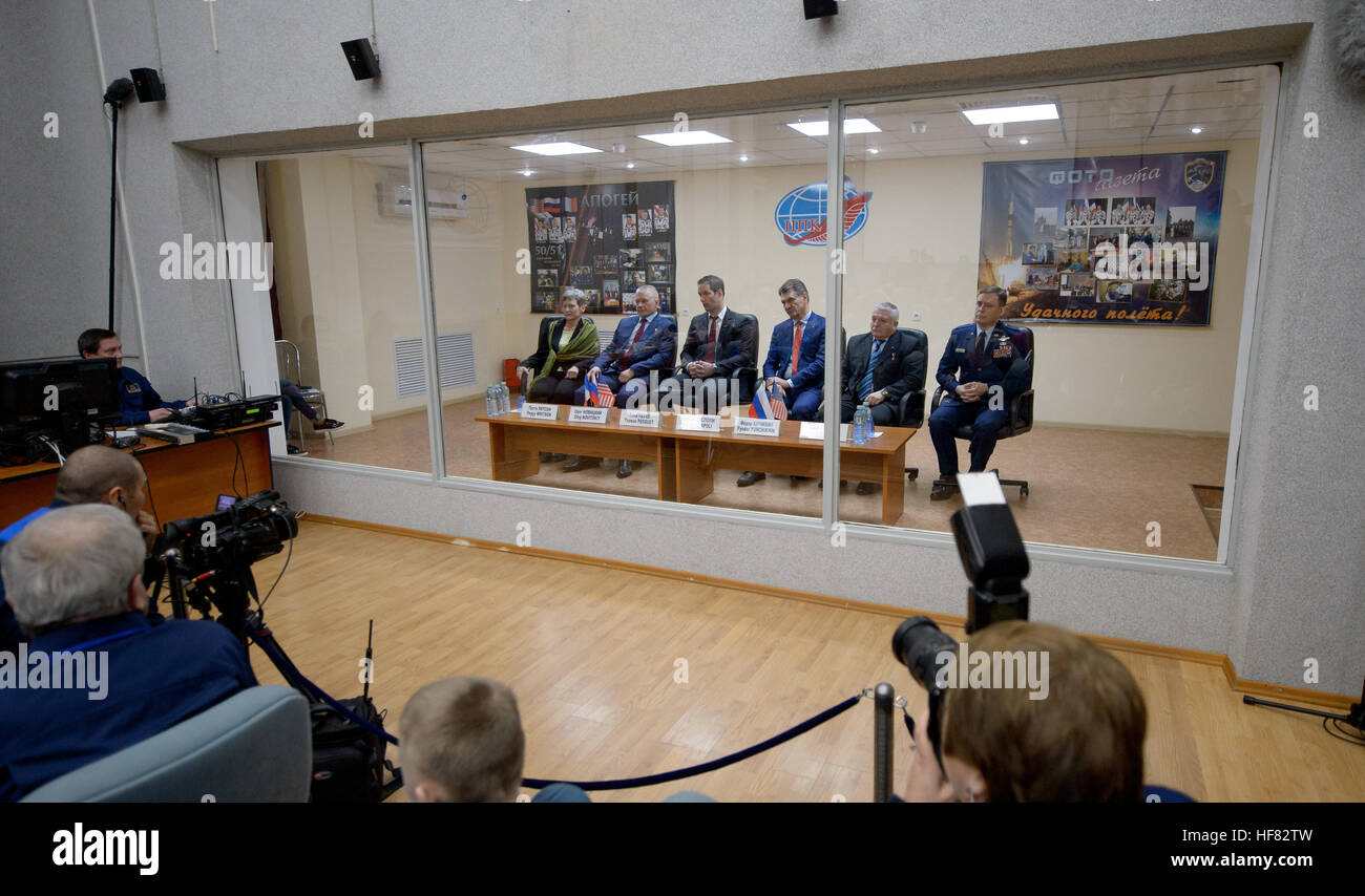 Expedition 50 prime and backup crews are seen in quarantine behind glass during the State Commission meeting to - Stock Image