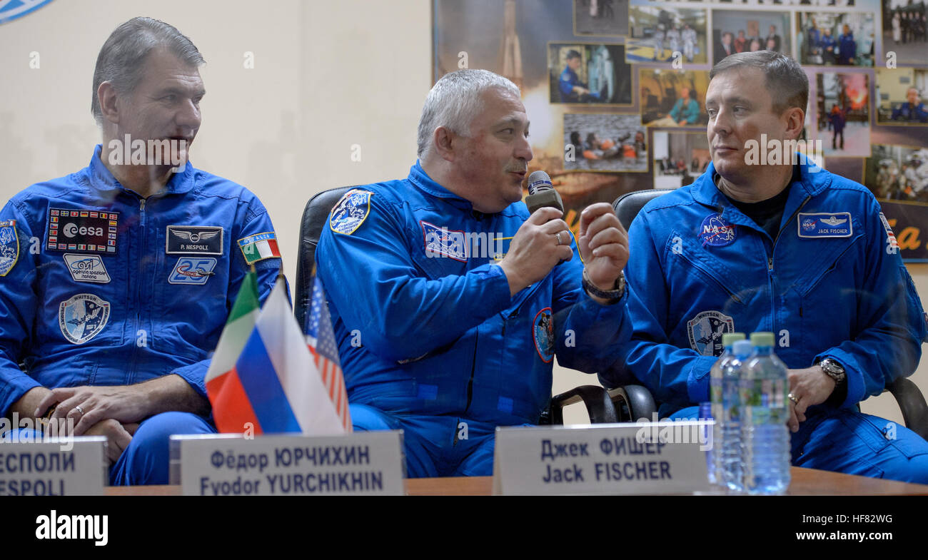 Expedition 50 backup crews members are seen in quarantine behind glass during a crew press conference, from left, - Stock Image