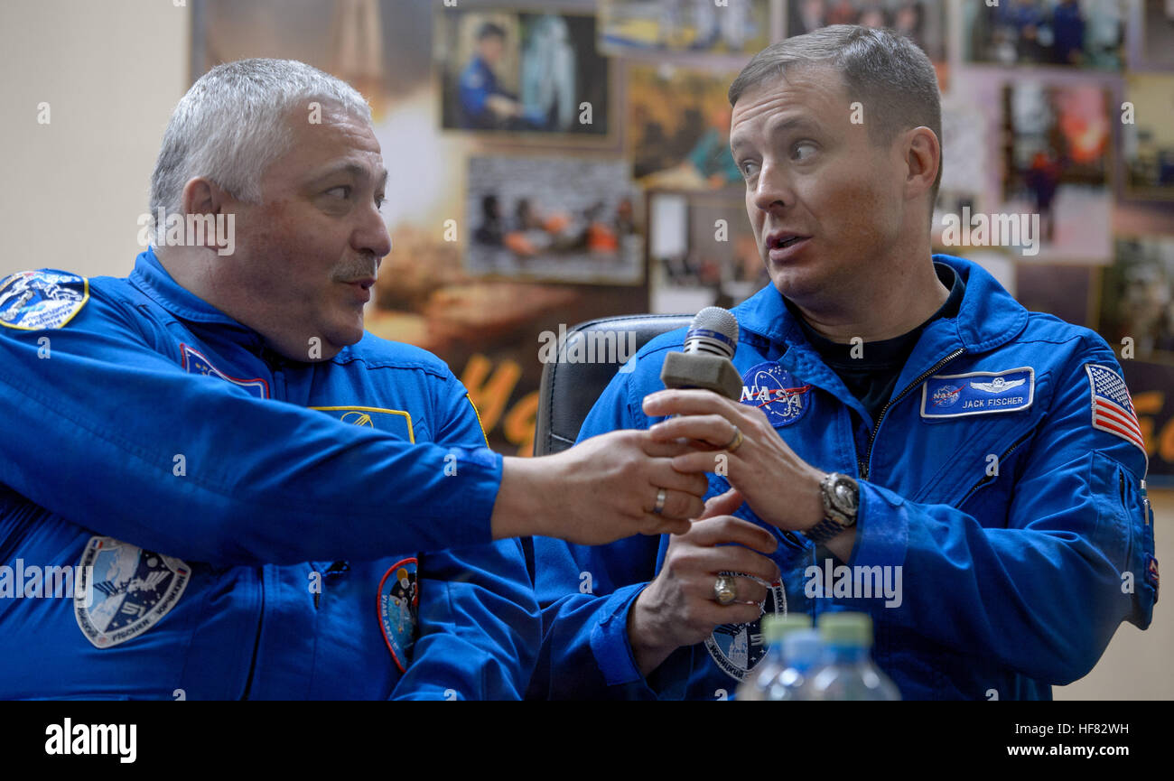 Expedition 50 backup crew members are seen in quarantine behind glass during a crew press conference, from left, - Stock Image