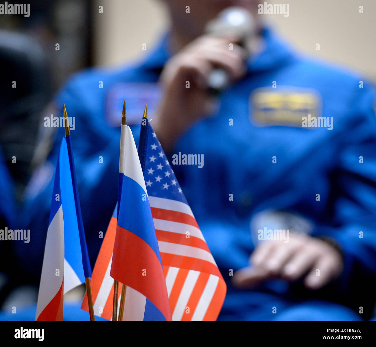 The French, Russian, and American flags are seen during a Expedition 50 crew press conference, Wednesday, Nov. 16, - Stock Image