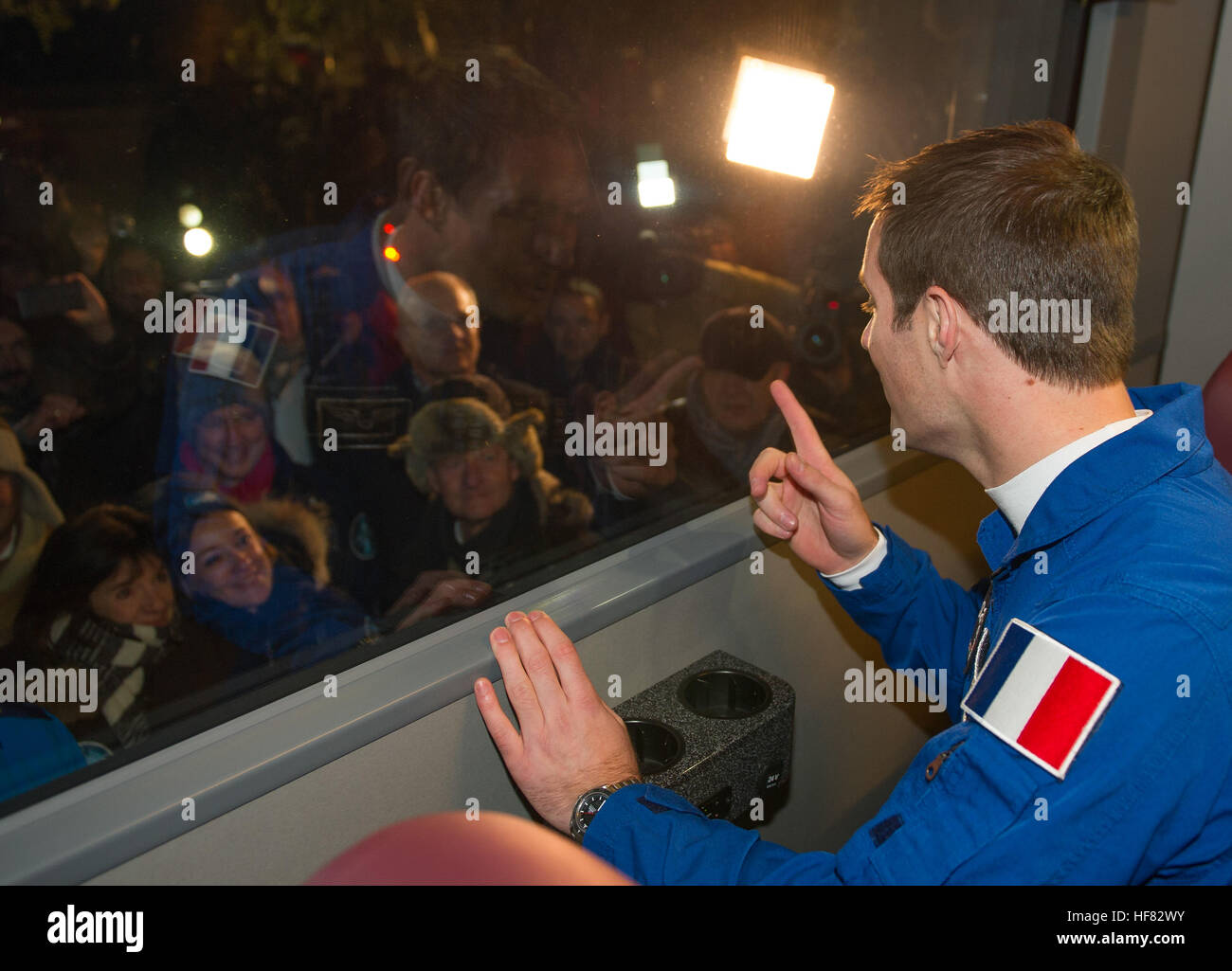 Expedition 50 ESA astronaut Thomas Pesquet waves farewell to family and friends as he, Russian cosmonaut Oleg Novitskiy - Stock Image