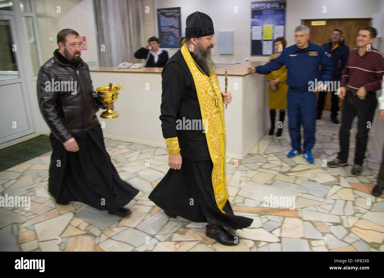 A Russian Orthodox Priest enters the Cosmonaut Hotel to bless the Expedition 50 crew members, Thursday, Nov. 17, - Stock Image