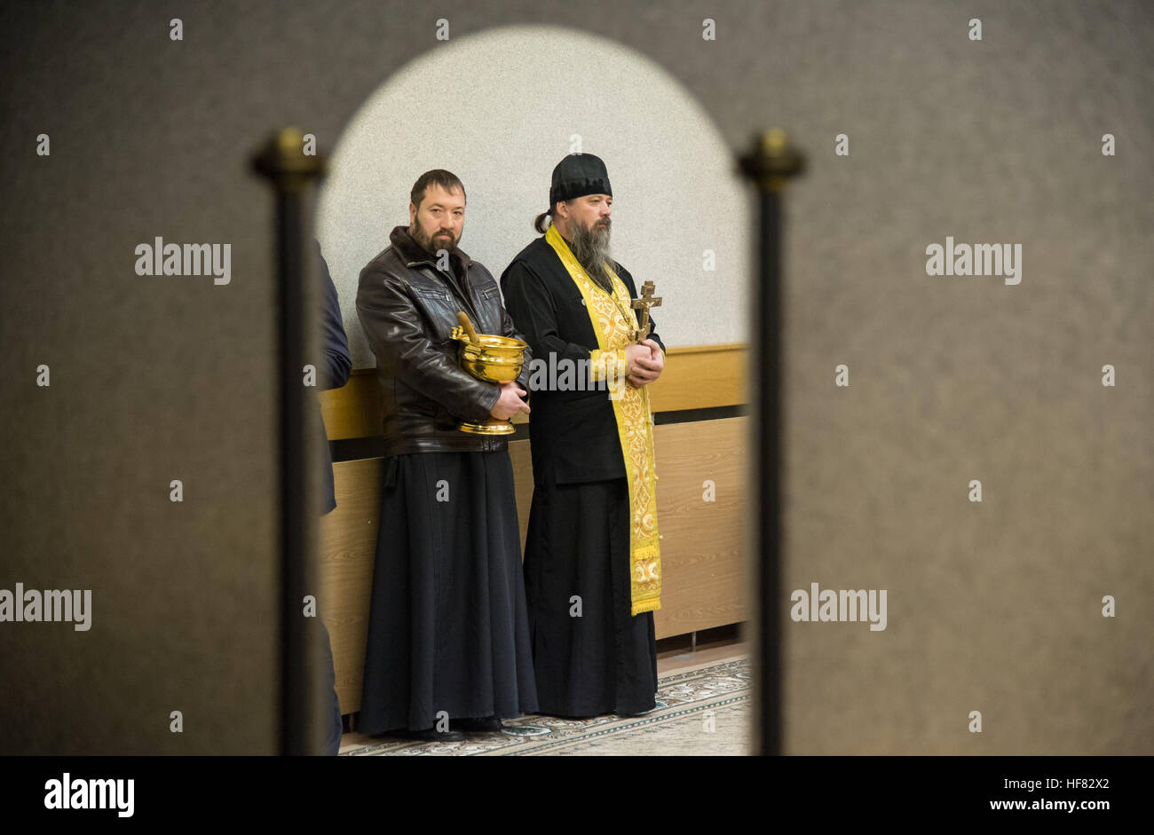 A Russian Orthodox Priest, right, waits to bless the Expedition 50 crew members at the Cosmonaut Hotel, Thursday, - Stock Image