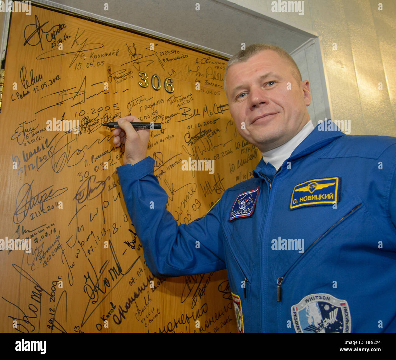 Expedition 50 Russian cosmonaut Oleg Novitskiy of Roscosmos performs the traditional door signing at the Cosmonaut - Stock Image