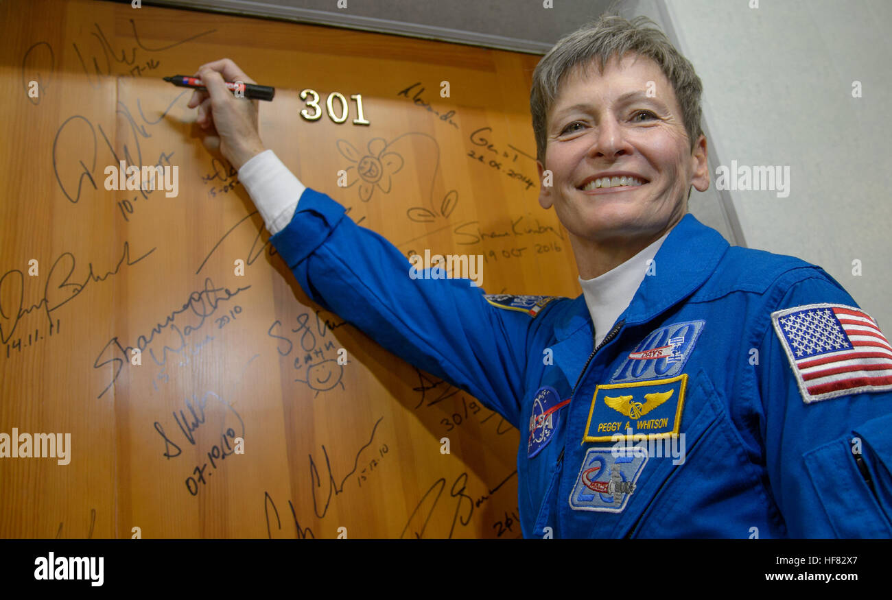Expedition 50 NASA astronaut Peggy Whitson performs the traditional door signing at the Cosmonaut Hotel prior to - Stock Image
