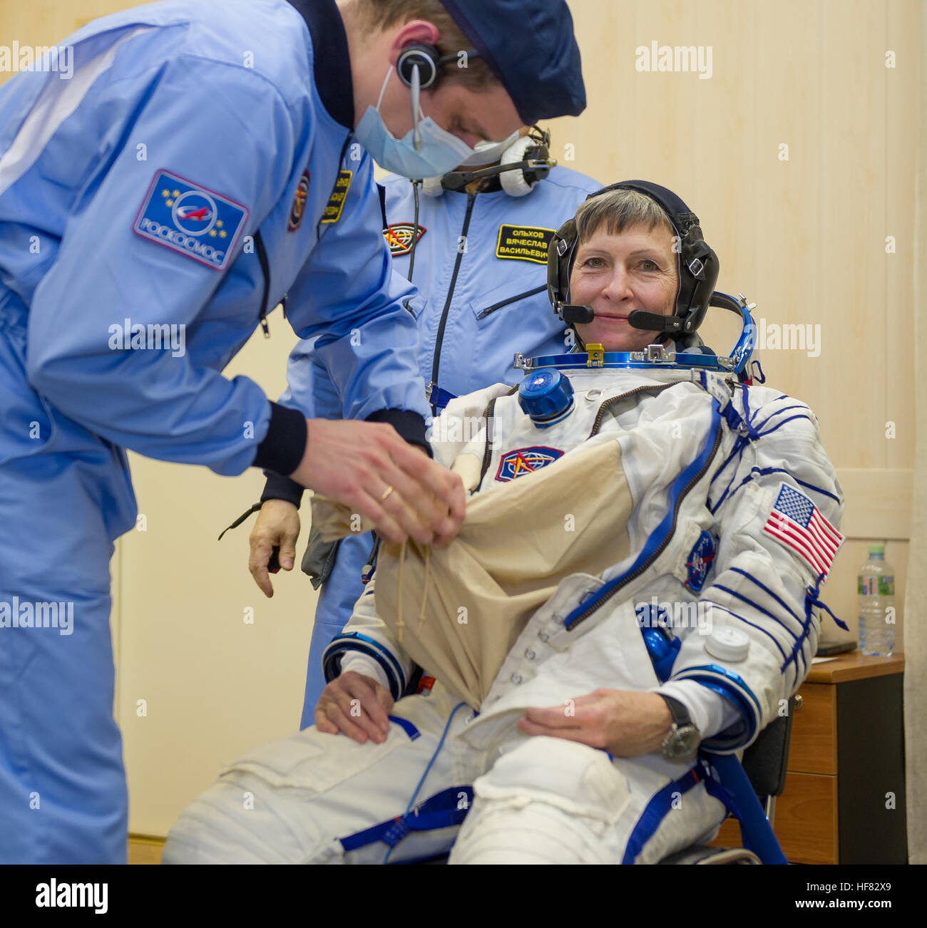Expedition 50 NASA astronaut Peggy Whitson is seen donning her Russian sokol suit a few hours ahead of her launch - Stock Image