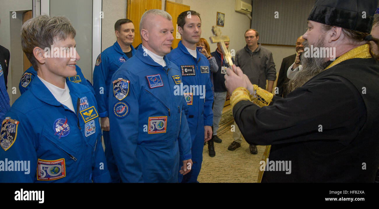 Expedition 50 NASA astronaut Peggy Whitson, left, and  Russian cosmonaut Oleg Novitskiy of Roscosmos, center, and - Stock Image