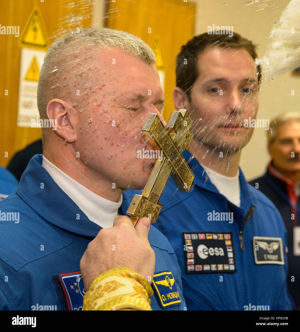 Expedition 50 Russian cosmonaut Oleg Novitskiy of Roscosmos receives a traditional blessing from a Russian Orthodox - Stock Image