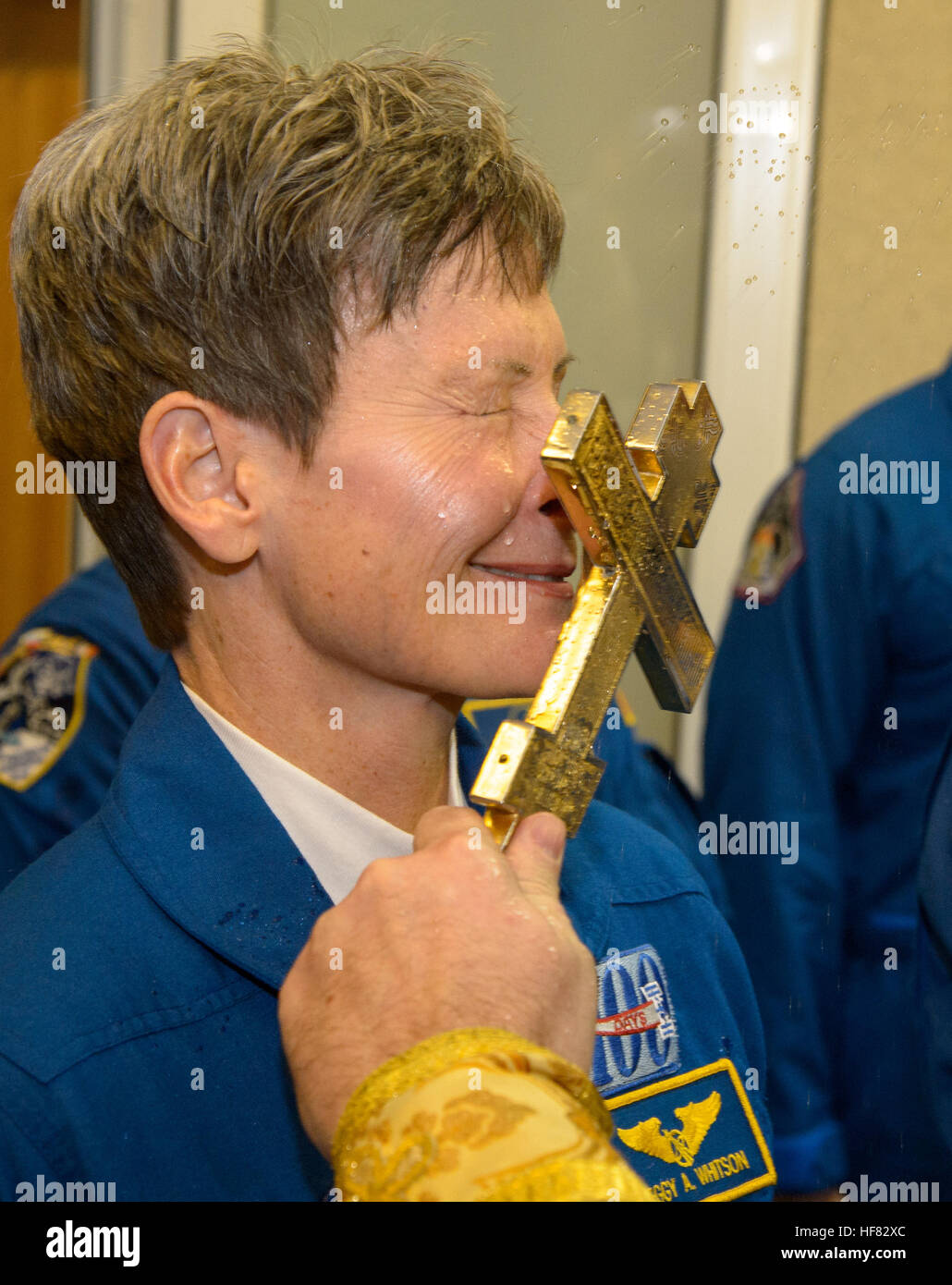 Expedition 50 NASA astronaut Peggy Whitson receives a traditional blessing from a Russian Orthodox Priest prior - Stock Image