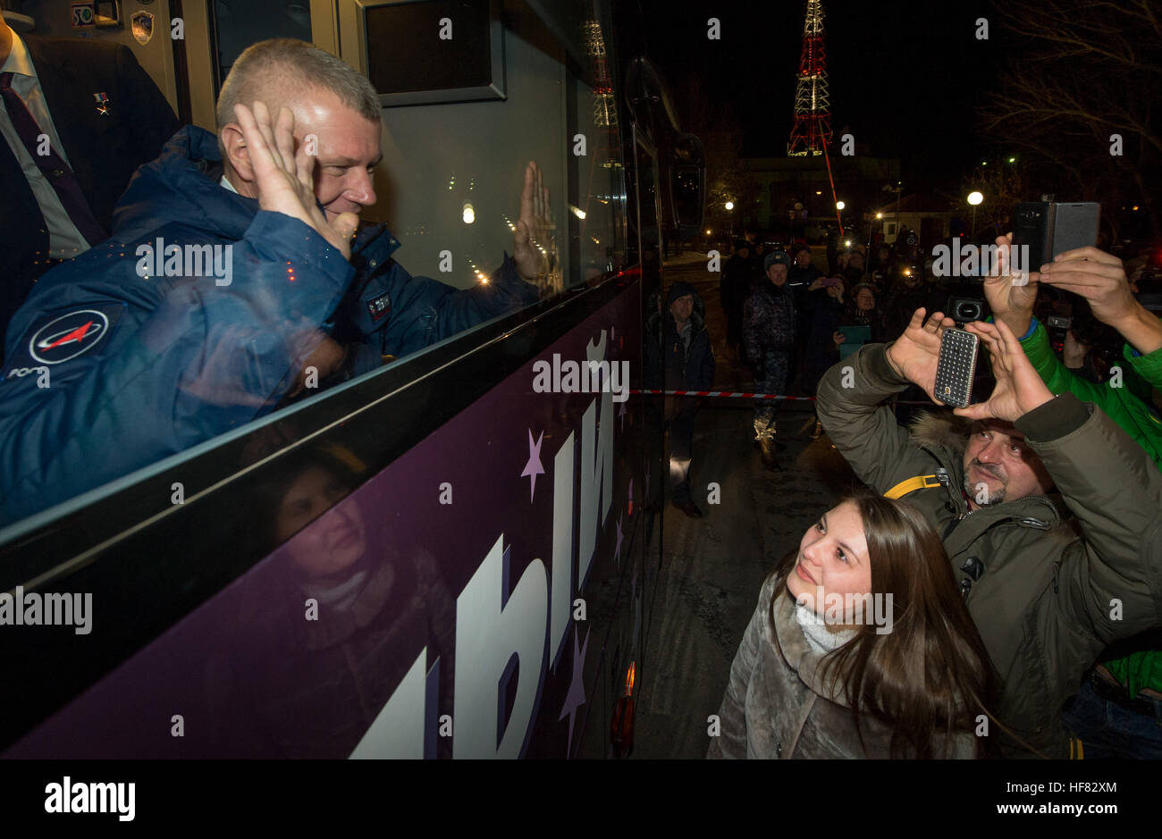 Expedition 50 Russian cosmonaut Oleg Novitskiy of Roscosmos waves farewell to family and friends as he and NASA - Stock Image