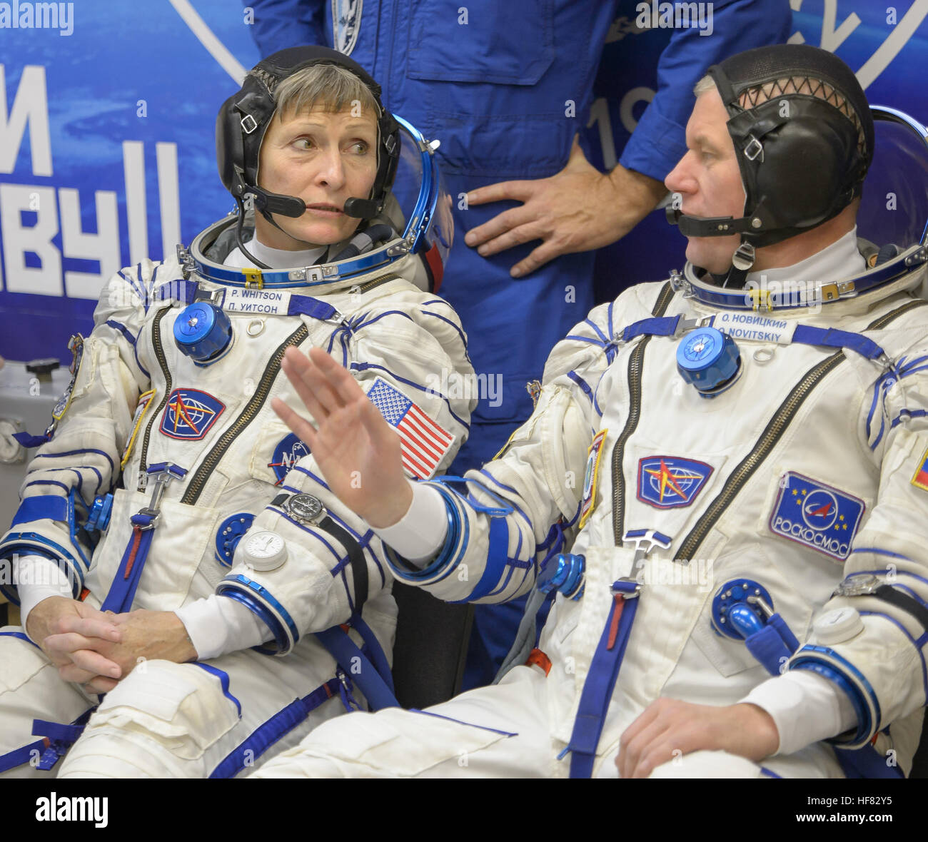 Expedition 50 NASA astronaut Peggy Whitson, left, and Russian cosmonaut Oleg Novitskiy of Roscosmos are seen after - Stock Image