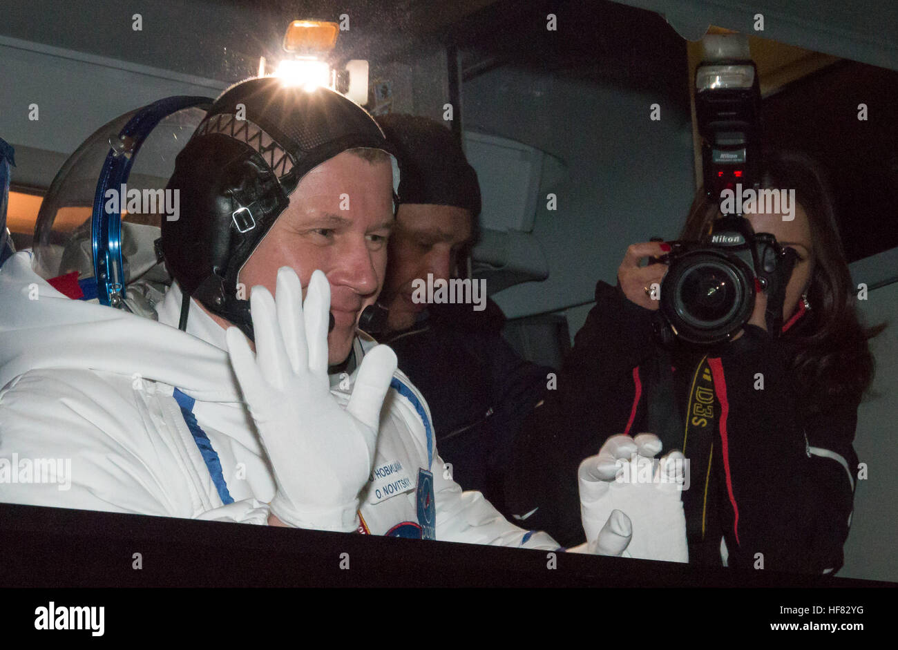 Expedition 50 Russian cosmonaut Oleg Novitskiy of Roscosmos waves farewell to friends and family as he and ESA astronaut - Stock Image