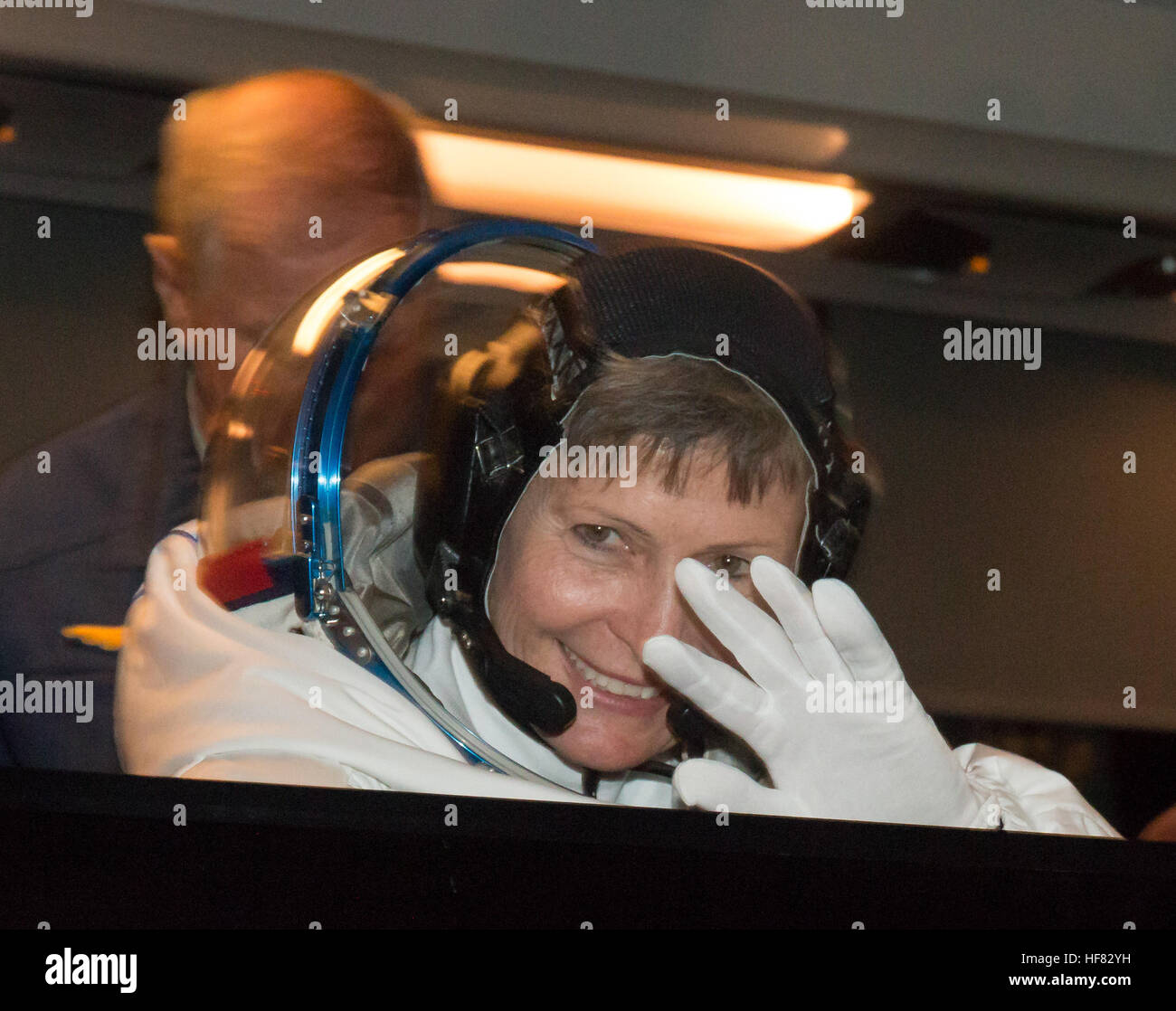 Expedition 50 NASA astronaut Peggy Whitson waves farewell to friends and family as she and ESA astronaut Thomas - Stock Image
