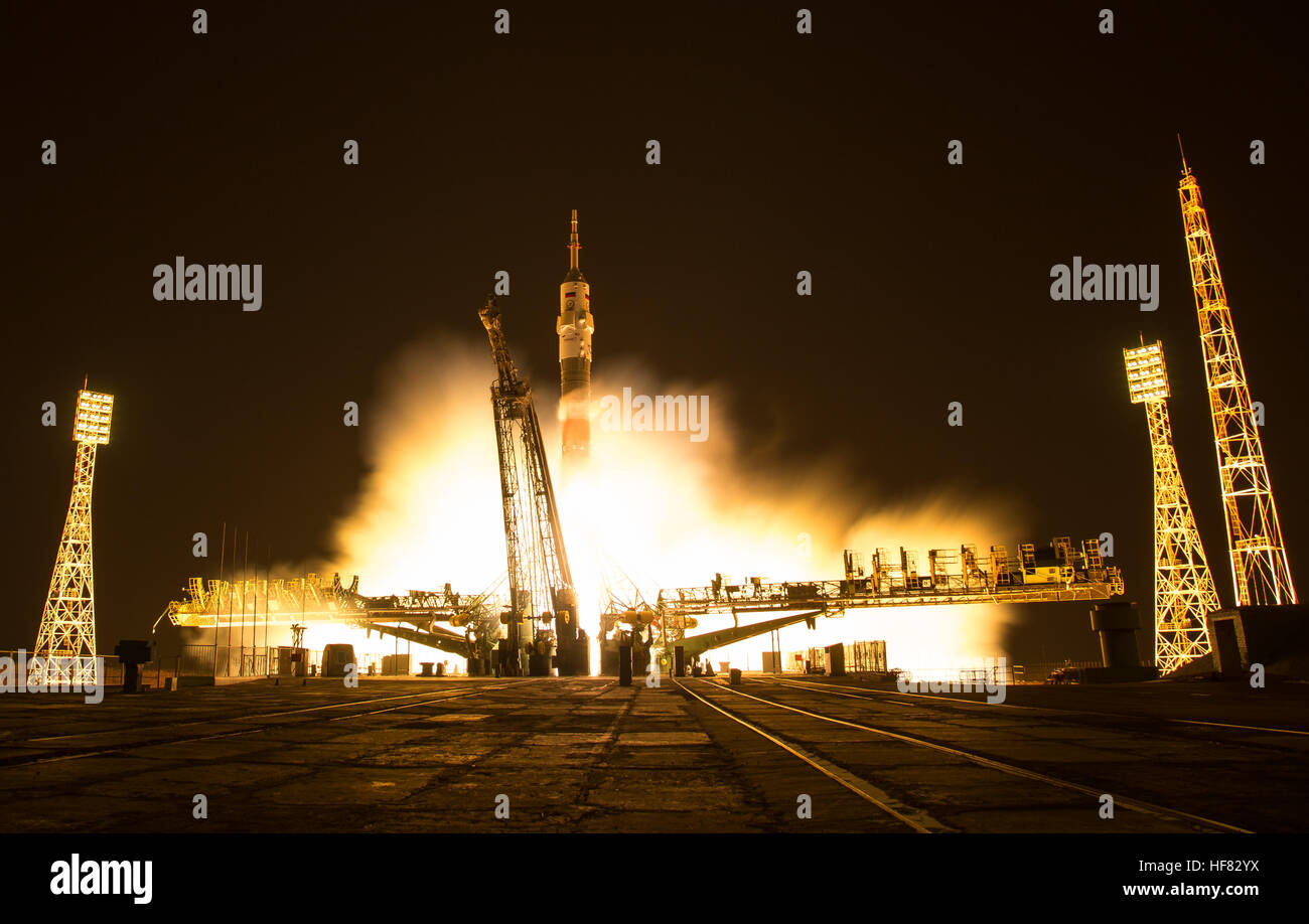In this one second exposure photograph, the Soyuz MS-03 spacecraft is seen launching from the Baikonur Cosmodrome - Stock Image