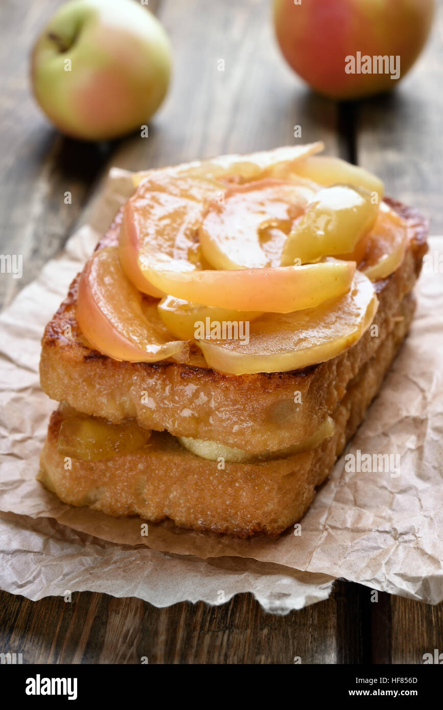 Sweet sandwiches, caramelized apples on toast bread, shallow depth of field - Stock Image
