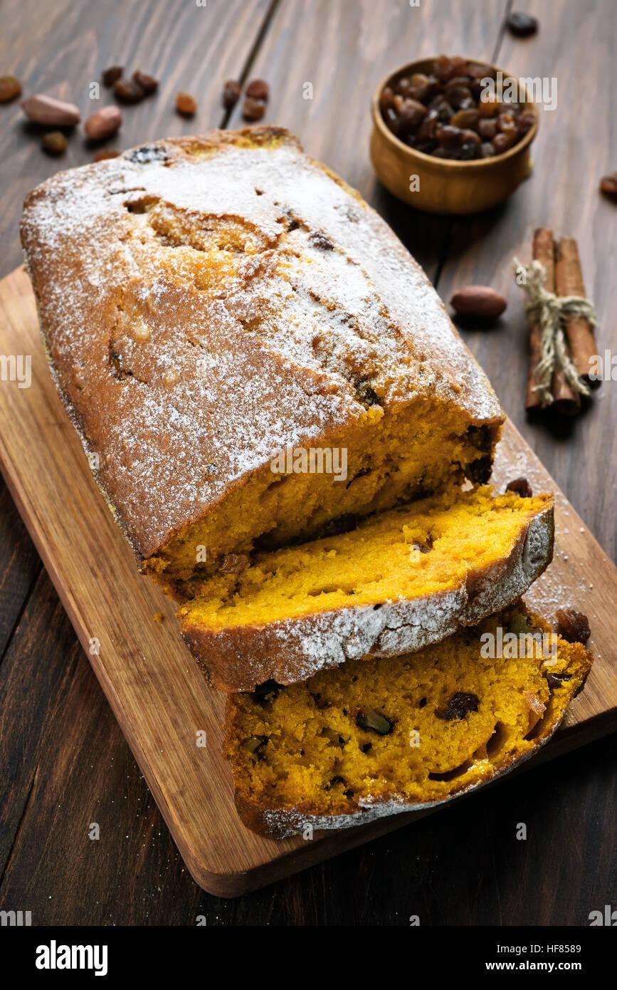 Sliced pumpkin bread on a cutting board - Stock Image
