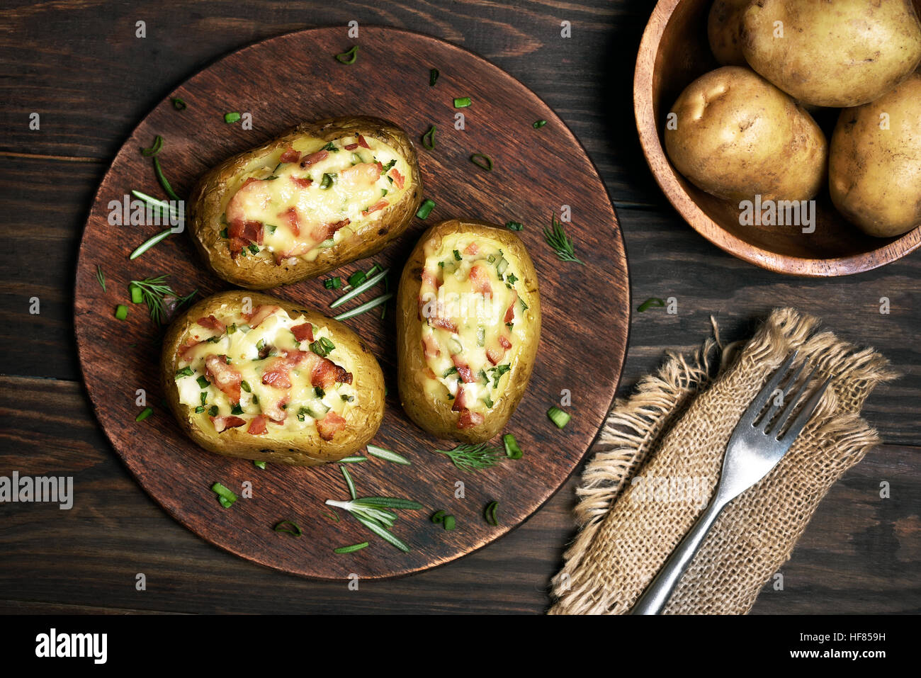 Baked stuffed potatoes with bacon, green onion and cheese, top view - Stock Image