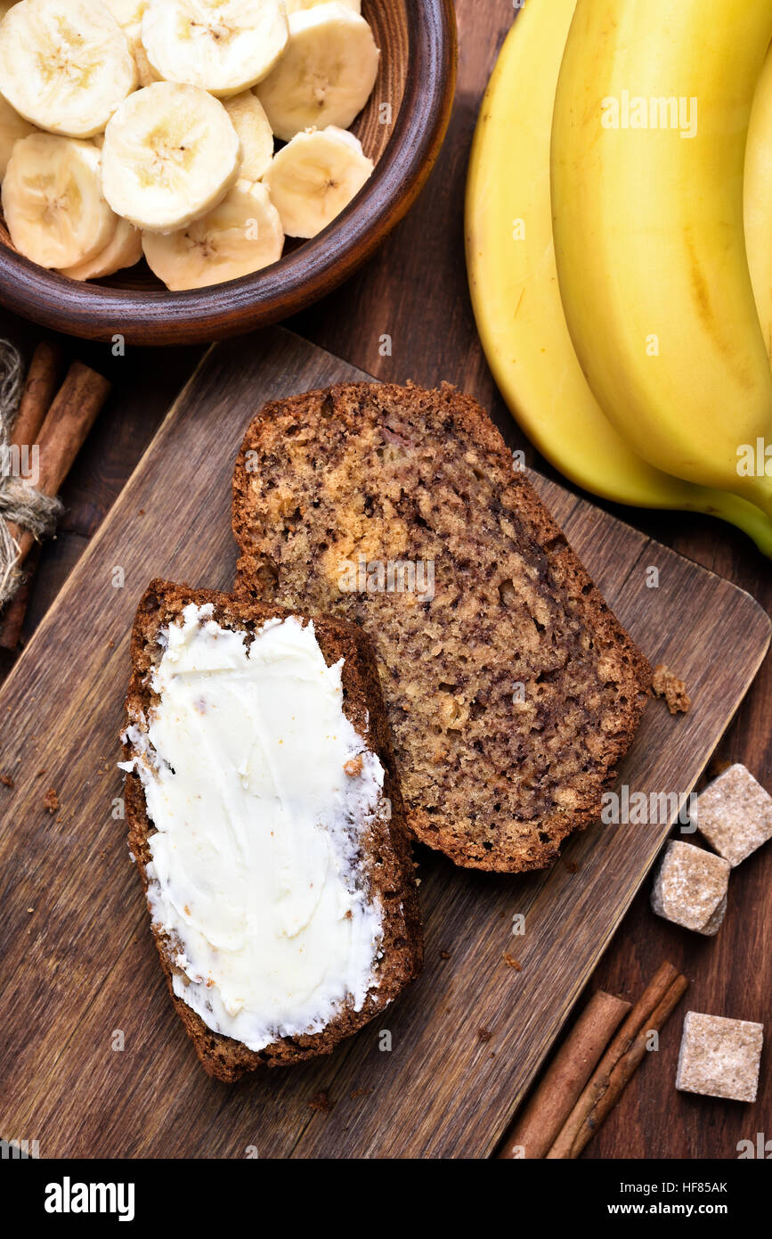 Butter on slices of banana bread - Stock Image