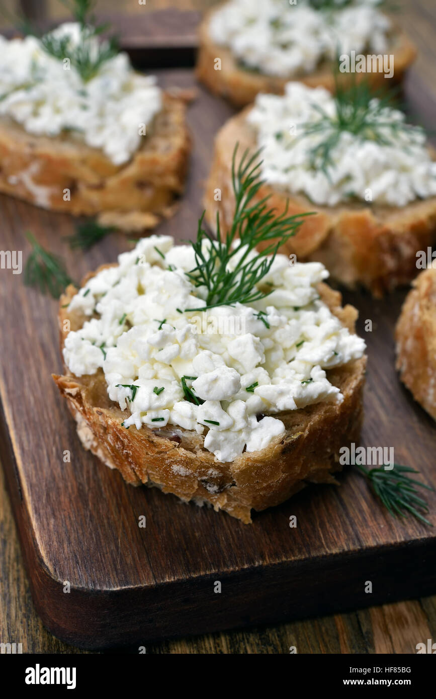 Healthy food, sandwich with wholegrain bread, curd cheese and dill - Stock Image