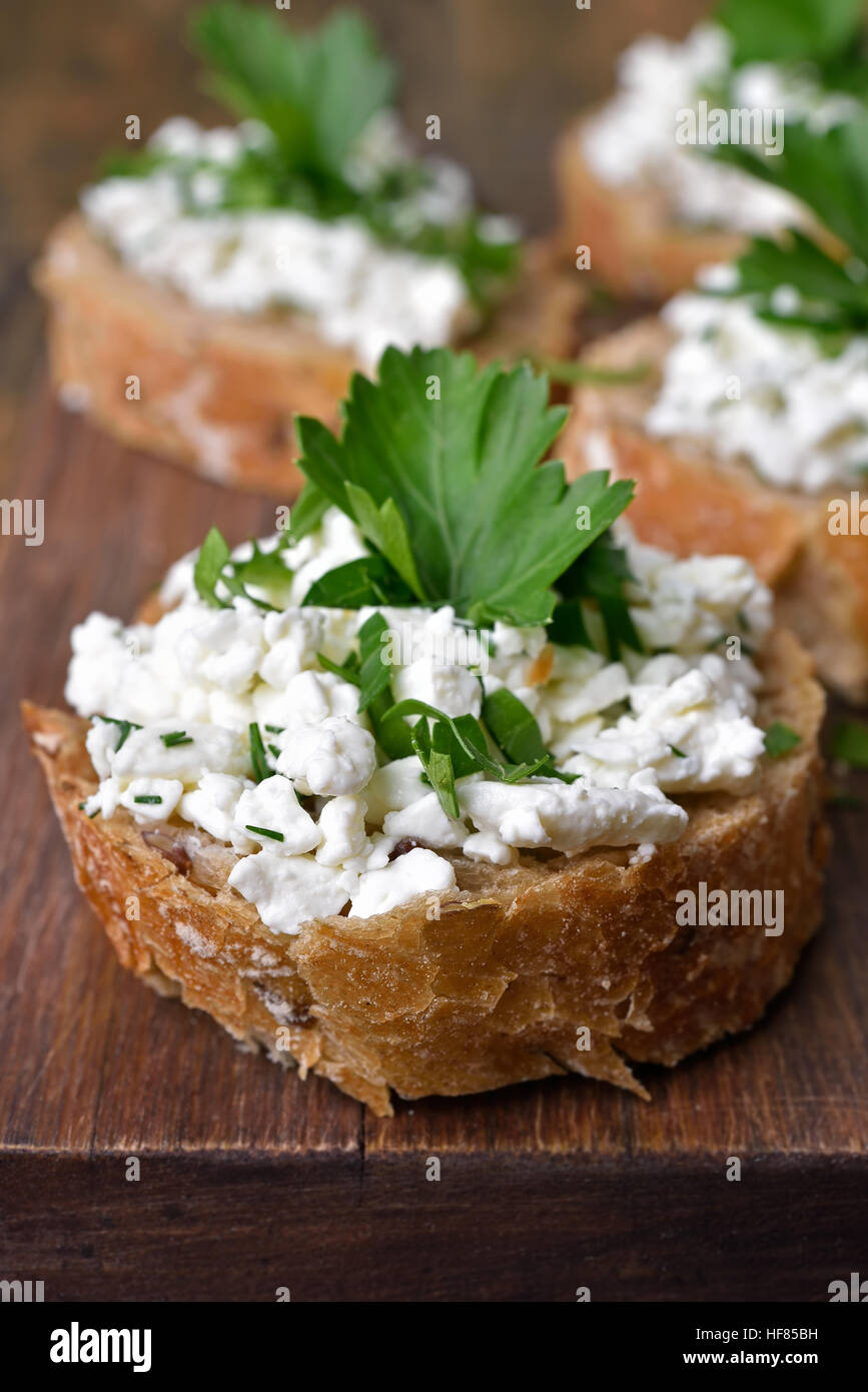 Sandwich with wholegrain bread, curd cheese and dill, healthy snack Stock Photo