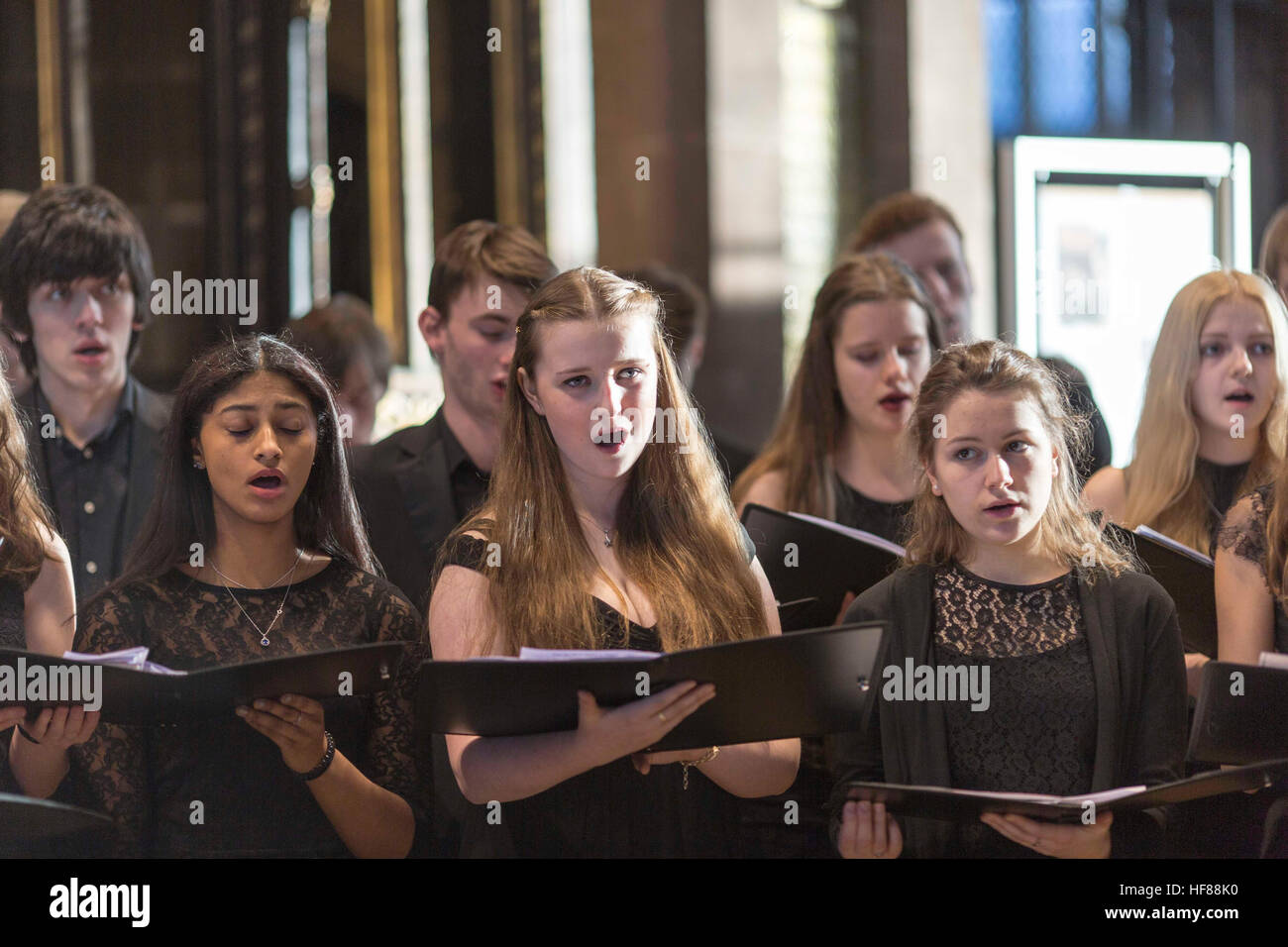 Interior of Manchester Cathedral during a service. Chetham's School of Music choir sings - Stock Image
