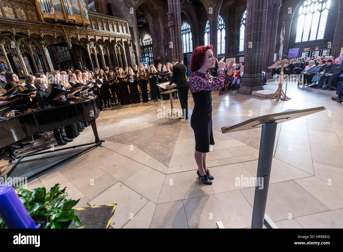 Interior of Manchester Cathedral during a service. A sign language interpreter - Stock Image
