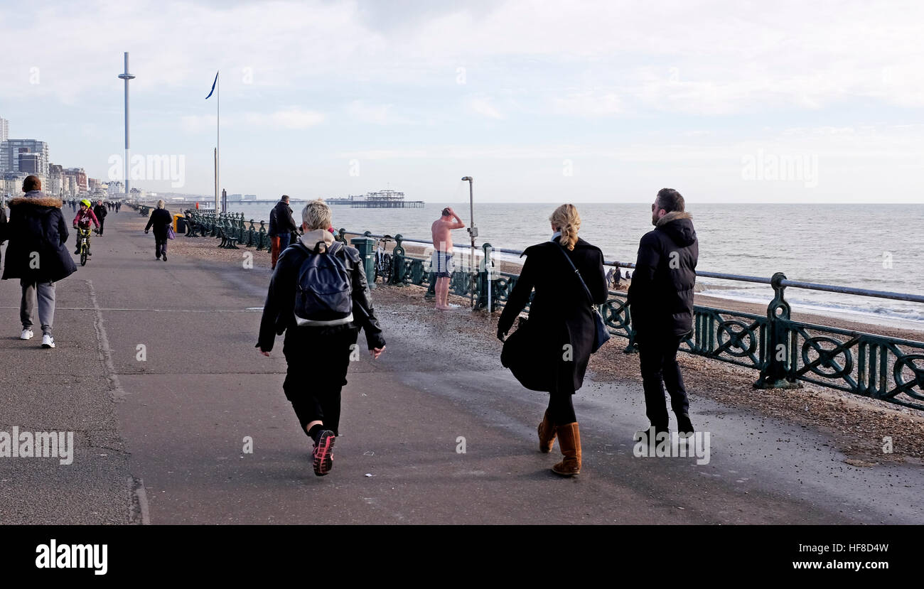 Brighton UK 28th December 2016 - It was a beautiful afternoon for a walk or a shower along Brighton and Hove seafront - Stock Image