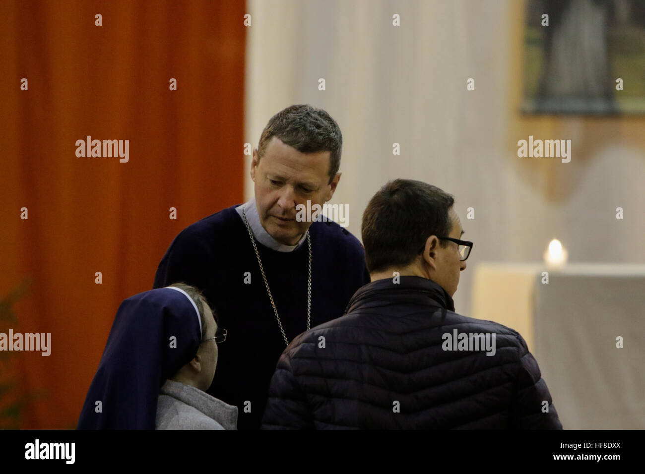 Latvia, Riga. 28th December 2016. Alain de Raemy (centre), the bishop of the Roman Catholic Diocese of Saint-Die - Stock Image