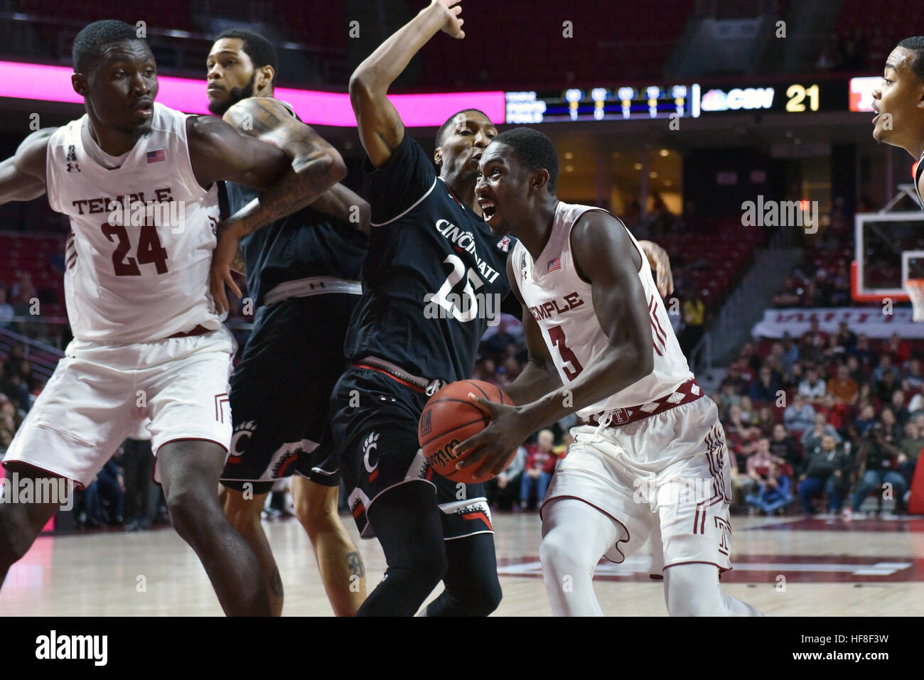 b96850265ca (3) drives down the lane by Cincinnati Bearcats guard KEVIN JOHNSON (25)  during the American Athletic Conference basketball game being ...