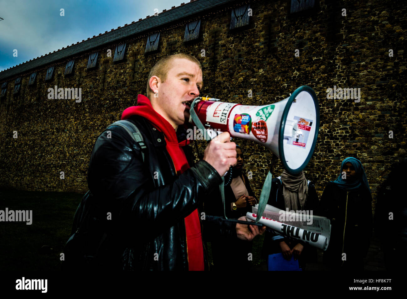 Cardiff, UK. 29th Dec, 2016. Demonstrators gather at Cardiff Castle in Wales to raise awareness and show their solidarity Stock Photo