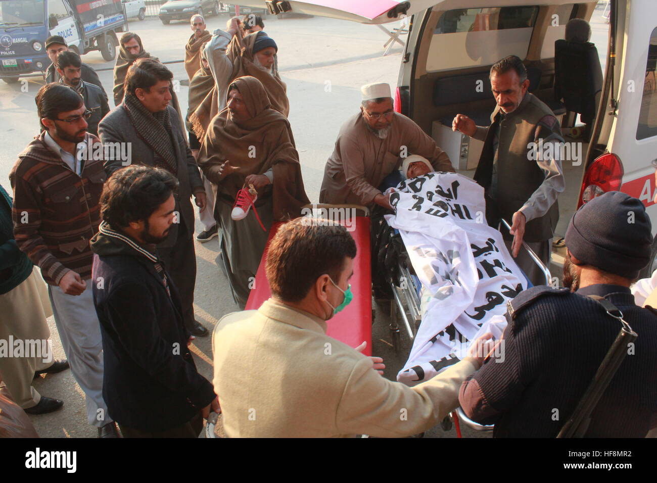 Abbottabad, Pakistan. 30th Dec, 2016. Local men Shifting Injured in hospital, at least 5 People Killed & 8 sustain Stock Photo