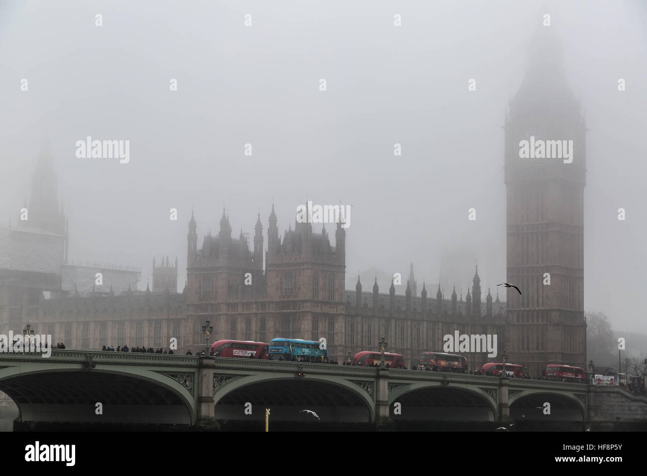 London, UK. 30th December, 2016. UK Weather: Westminster's Parliament buildings and Big Ben seen just visible through Stock Photo