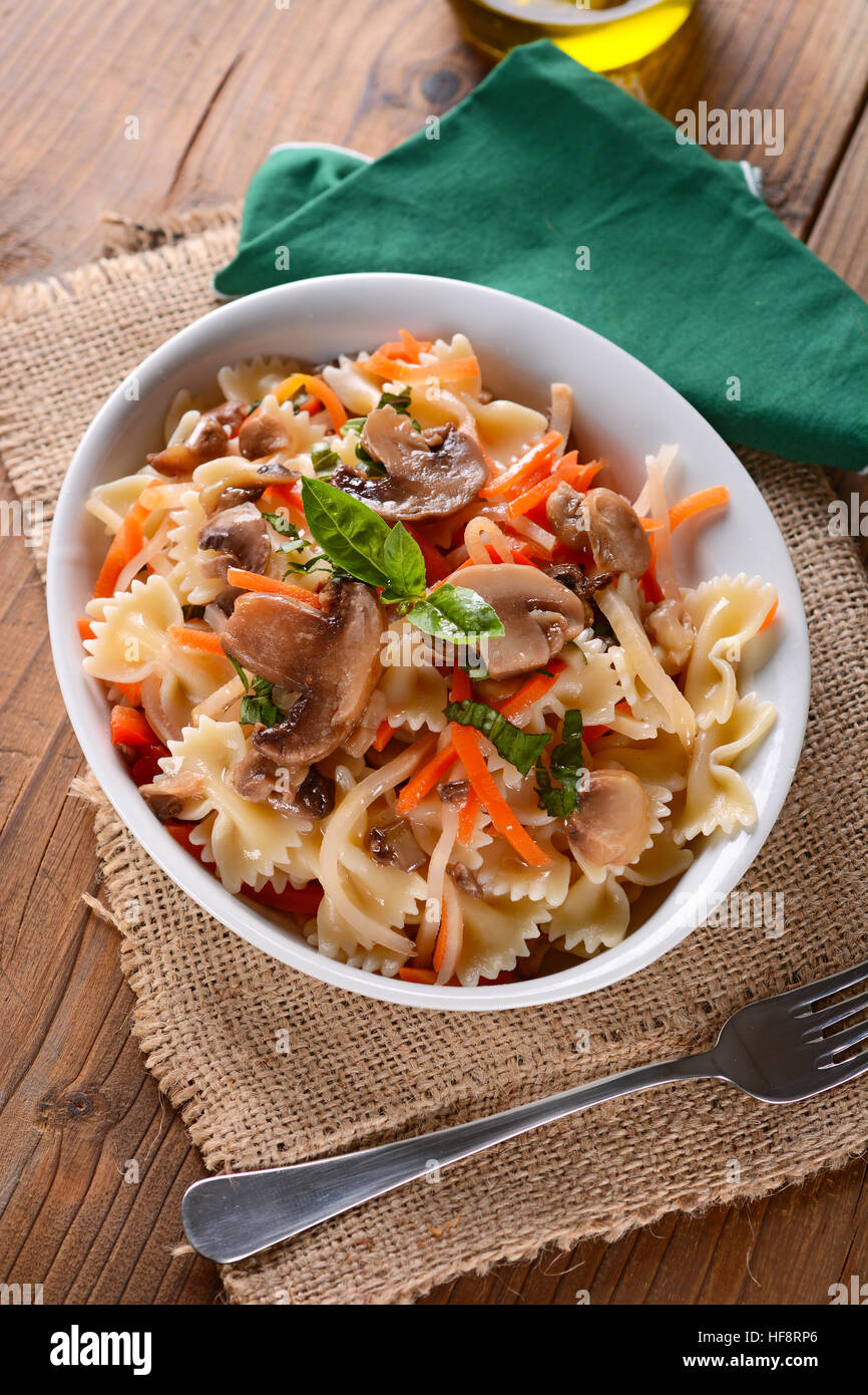 pasta with mushrooms and vegetables - Stock Image