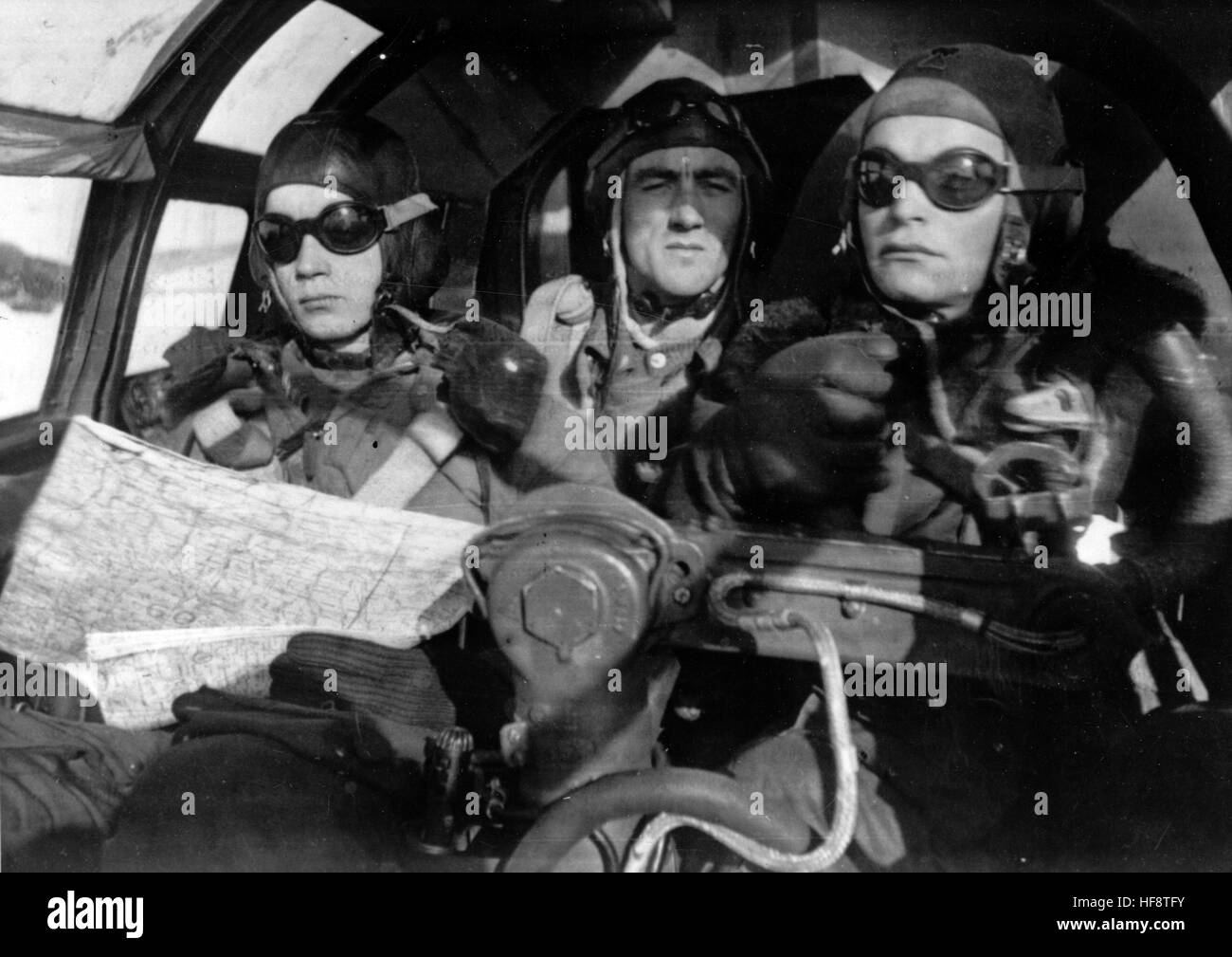 The Nazi propaganda image shows the crew of a German Wehrmacht Heinkel He 111 on a mission on the Eastern Front. - Stock Image