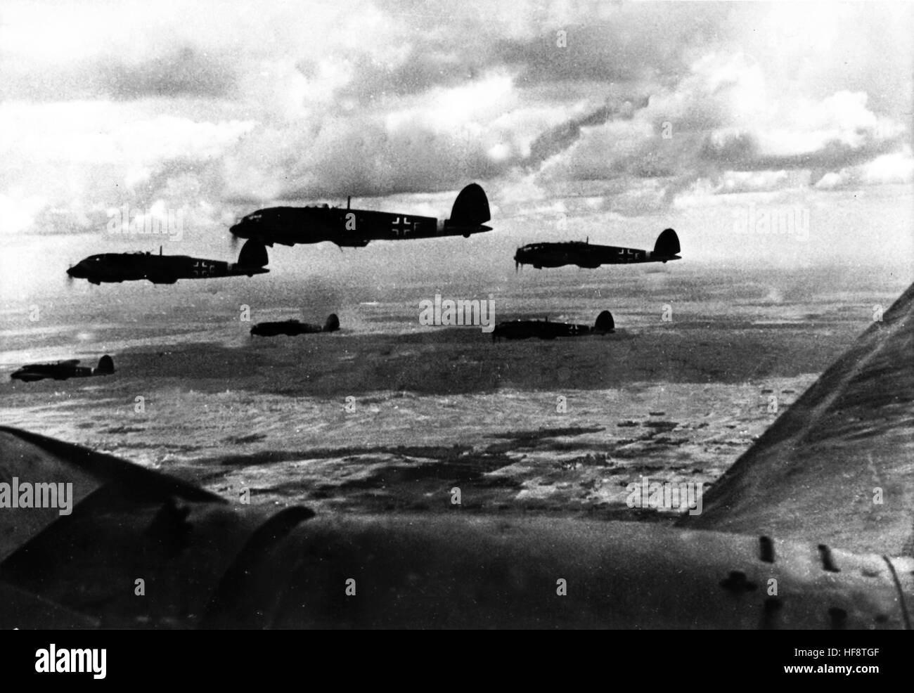 The Nazi propaganda image shows German Wehrmacht Heinkel He 111 combat planes out on a mission on the Eastern Front. - Stock Image