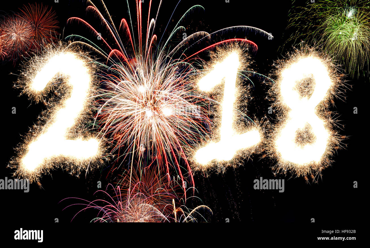 3d rendering of happy new year fireworks with the year 2018 lit up in glowing sparkles and light