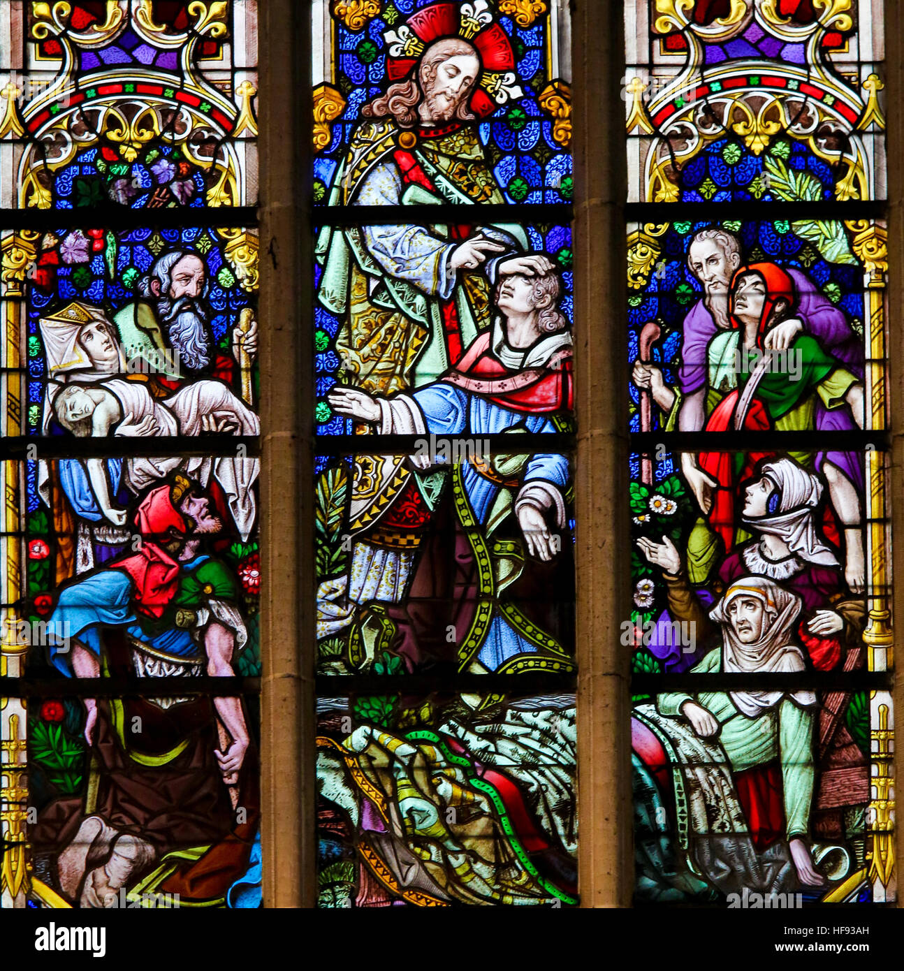 Stained Glass window depicting Healings by Jesus Christ in the Cathedral of Saint Bavo in Ghent, Flanders, Belgium. - Stock Image