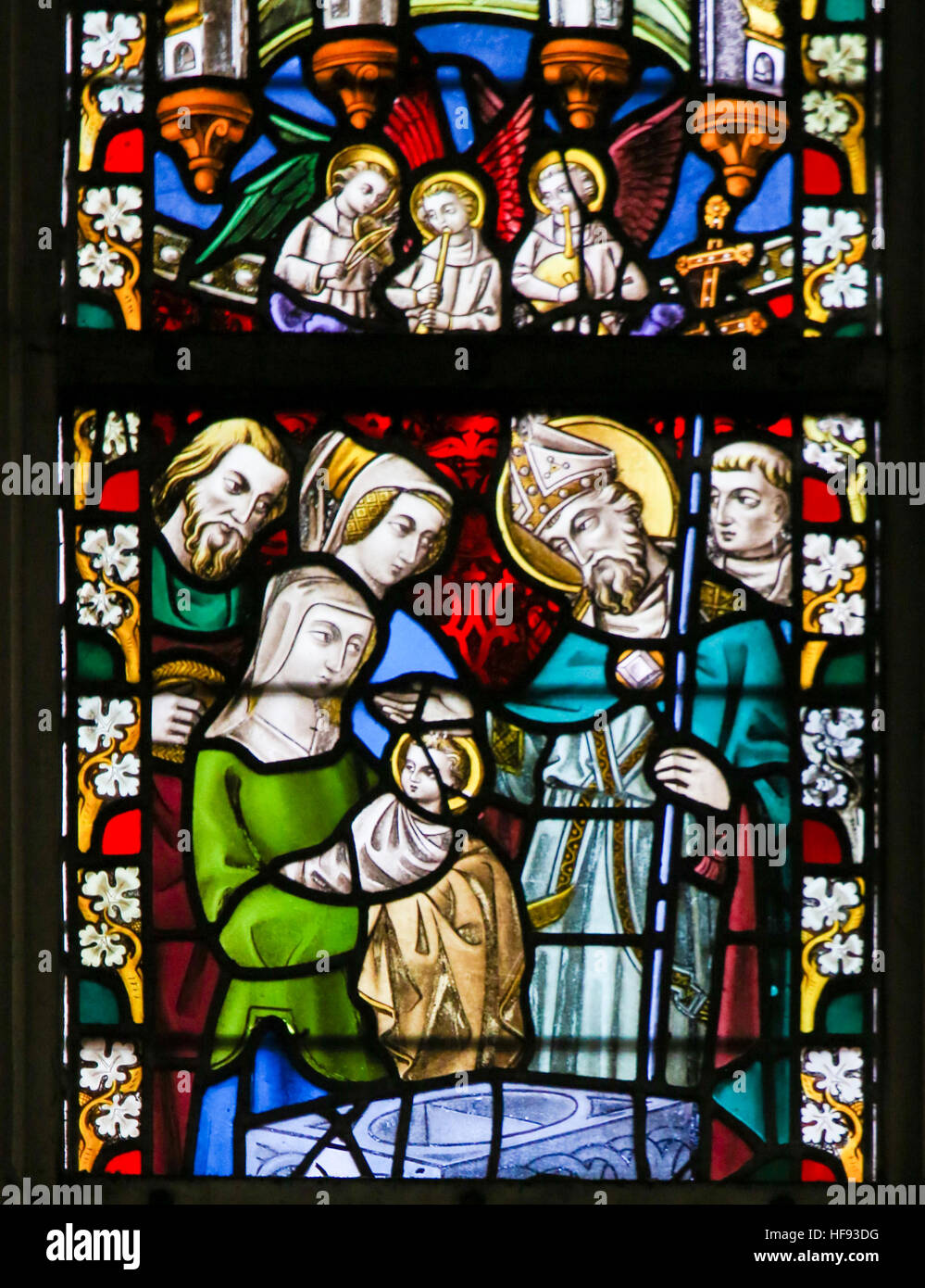 Stained Glass window depicting a Baptism in the Cathedral of Saint Bavo in Ghent, Flanders, Belgium. - Stock Image