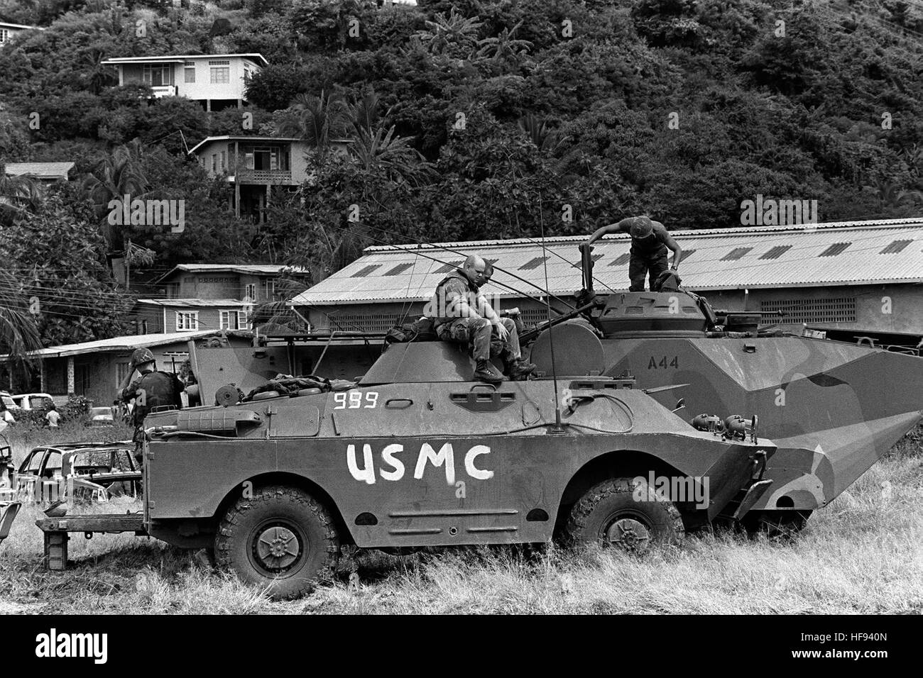 Marines sit aboard a captured Soviet BRDM-2 Amphibious scout car, foreground, and an LVTP7 tracked landing vehicle - Stock Image