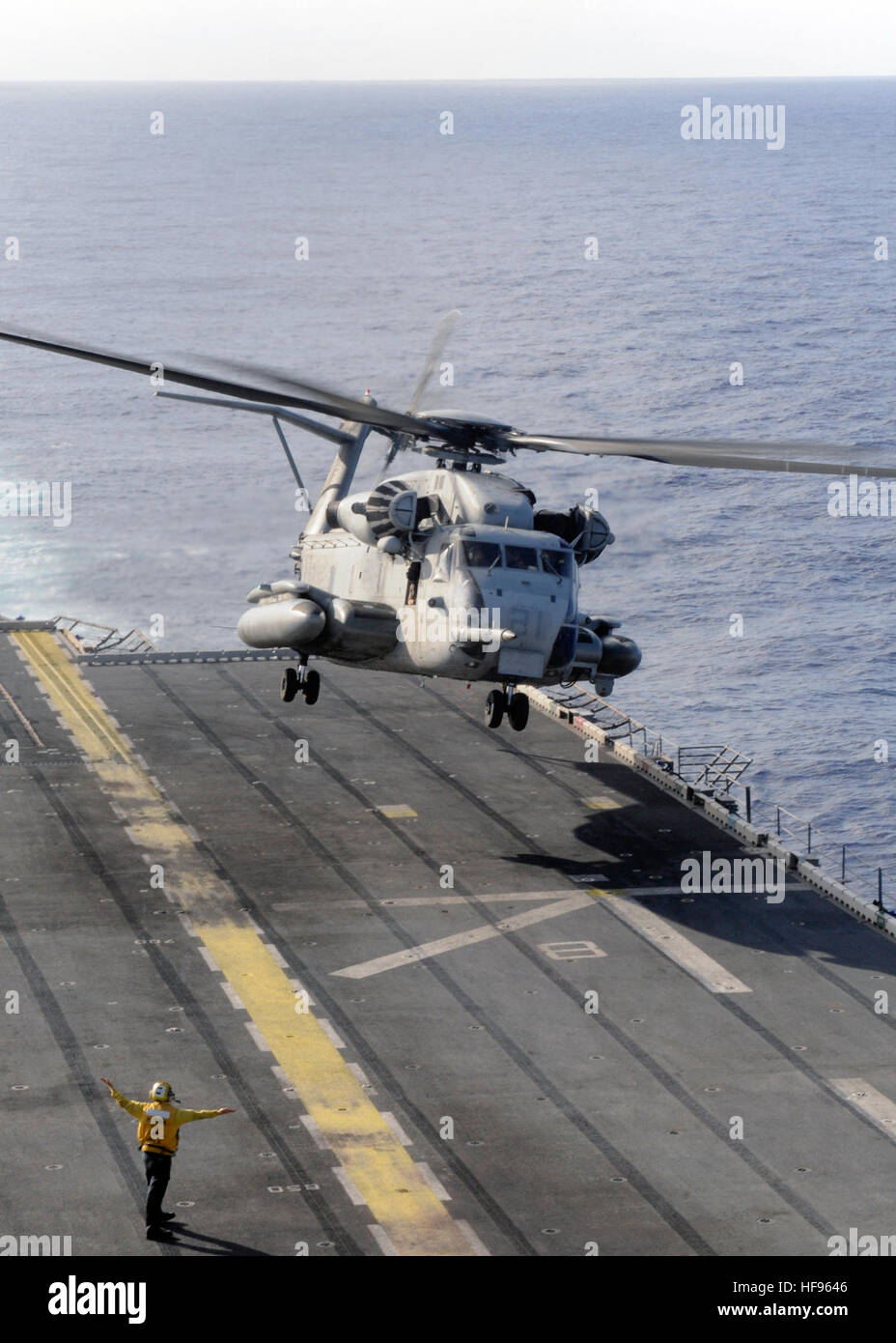 A CH-53 Sea Stallion launches from the flight deck of the amphibious assault ship USS Peleliu (LHA 5). Peleliu is - Stock Image