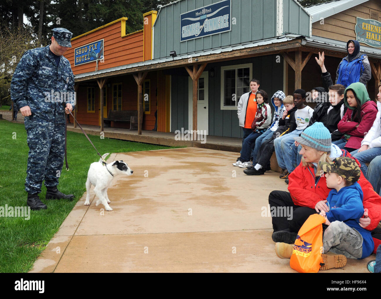 Children participating in a Kids' Day Deployment meet Zorro, a military working dog and his handler, Petty Officer - Stock Image